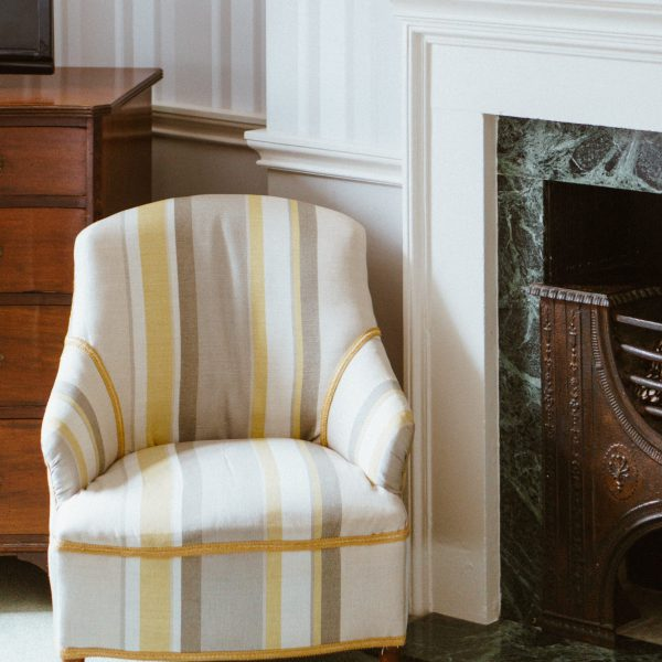 white-yellow-and-gray-striped-arm-chair-2747070